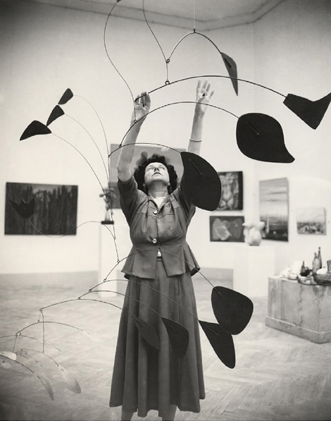 Peggy Guggenheim with a Calder mobile