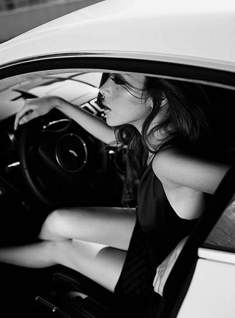 Lady in an Aston Martin