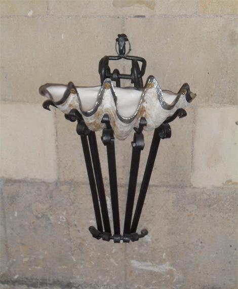 Gaudi holy water stoop