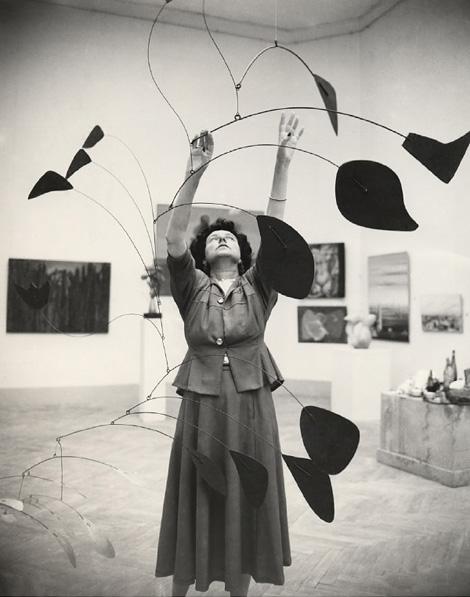 Peggy Guggenheim with a Calder mobile