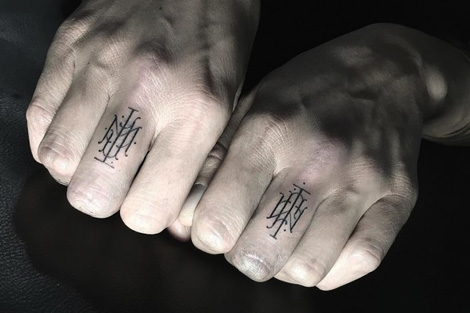 Fine line typographic tattoos
