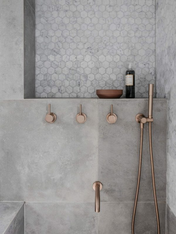 Copper and concrete shower luxe